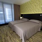 Art_Hotel_Szeged__zld_tapts_szoba__